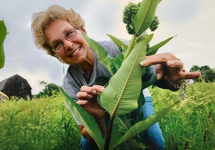 Lynn in a field with milkweed